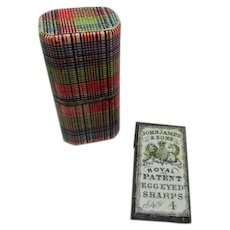 A paper covered Tartan Ware needle packet box.