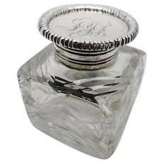 Silver lidded glass desk top ink well. HM. London 1890