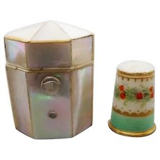 Mother of pearl thimble box and old porcelain thimble. c 1860