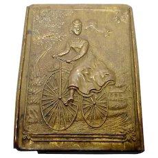 Leonardt brass nib box with bicycle decoration. c1880