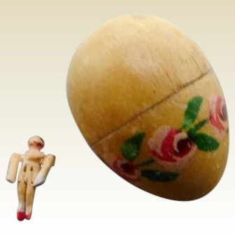 Tiny jointed doll in a wooden egg.  19thc
