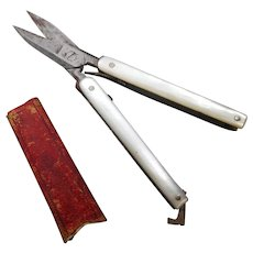 Folding pearl scissors and case. 19th century.