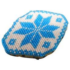 A bead work pin cushion. c 1820