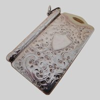 A chatelaine piece-a silver case with note slips and pencil. c 1890