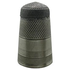 Reserved for Mrs A .                             x A tall Georgian silver thimble with a steel cap. Early 19th century c 1800
