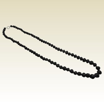 Whitby jet necklace of carved beads. 19th century