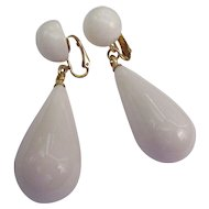 Kenneth J. Lane long white plastic dandle earrings