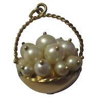 Fantastic 14k yellow gold basket full of pearls charm