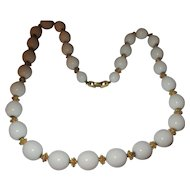 Early Trifari hard to find white ball necklace, with gold tone nugget spacers.