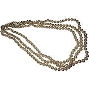Crowned Trifari three strand faux pearl necklace
