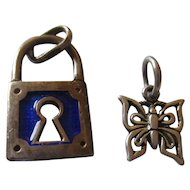 Two sterling charms Pad lock blue enamel / butterfly