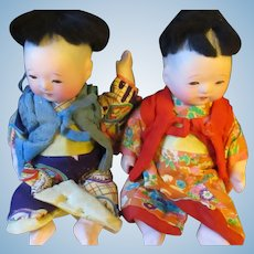 Vintage pair of Compostition, glass eyes, small Chinese dolls