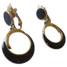 Pair of clamp Trifari black resin earrings