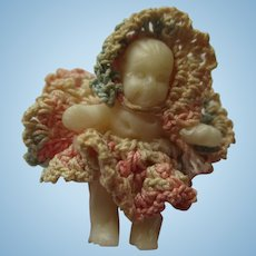 Vintage rubber baby with hand crochet clothes