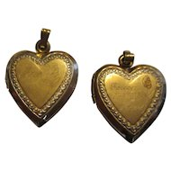 Pair of two 10k yellow gold locket pendants