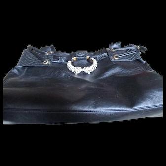 Kenneth J. Lane Faux black leather purse/metal white tiger bracelet type.