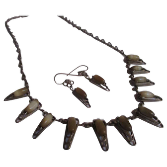 Unique tooth shaped glass stone set.