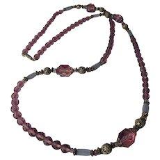 Vintage 1970's  long purple glass rhinestone necklace