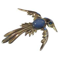 Vintage sterling silver bird in flight/blue moonglow glass stone.