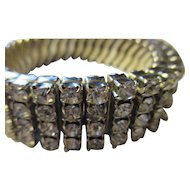 Four rows of bright shiny rhinestone expandable bracelet