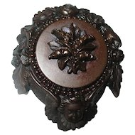Antique Gutta Percha Cherub brooch.