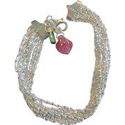 Nine Strand Sterling Silver Bracelet With Tourmaline Charms
