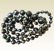 Fabulous 38 Inch Strand Faceted Jet or Glass Beads