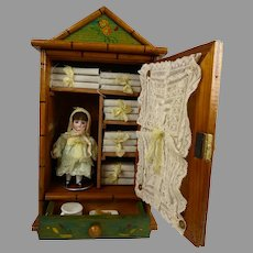 Exceptional Small Antique French Faux-Bamboo Linen Cabinet with all bisque doll and accessories