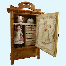 Antique French Doll Linen Cabinet with doll and accessories