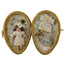 Original Antique wicker egg/presentation box with  five-piece  mignonette doll