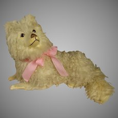 Exceptional Antique Original French Laying Spitz Papier Maché/ Mohair/ Fur Dog on his Cushion.