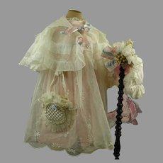 Five-piece Original Antique pique doll ensemble, dress, underdress, collar, bag and bonnet from the late nineteenth century
