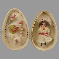 Original Antique  French Silk Egg Presentation Egg with doll and accessories