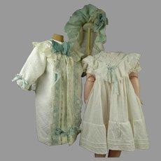 Four-piece Original Antique  pique doll ensemble, coat, collar, dress and bonnet from the late nineteenth century