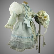 Wonderful French white dotted muslin antique dolls dress with blue silk flowered underdress and wired bonnet