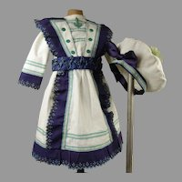 Marvelous French white pique mariner/sailor antique doll dress and matching beret.