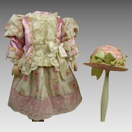 Exquisite pink and creamy flowered silk French antique dolls couturier dress with beautiful matching antique pink straw hat