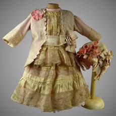 Exquisite French pink lace and silk one-piece antique dolls dress with original bonnet