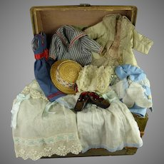 Antique original French doll domed travelling trunk with extensive antique trousseau