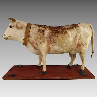 Antique Doll Pull Toy Cow giving mooing sound from 1880