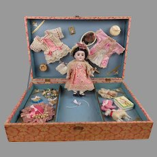 Adorable antique presentation box with all bisque doll, wardrobe and accessories