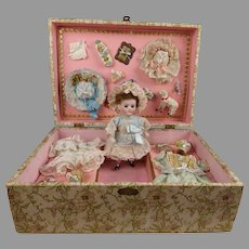 Exquisite antique presentation box with all bisque doll, wardrobe and accessories