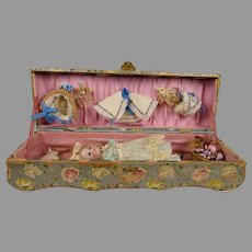 Adorable antique embossed presentation box with doll, clothing and accessories
