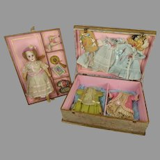 Adorable antique French presentation box with doll and trousseau