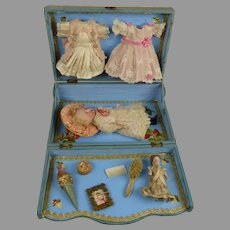 Exceptional antique presentation box with doll, wardrobe and accessories
