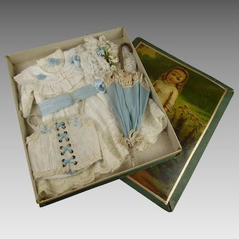 Exquisite French Antique  Presentation Box  with antique dress, bonnet, parasol and corset from ca 1890.