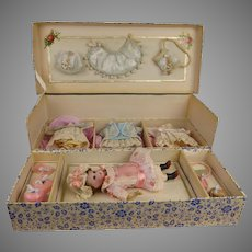 Marvelous antique presentation box with doll and extensive wardrobe