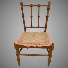 Small antique French faux-bamboo doll high chair with antique cushion