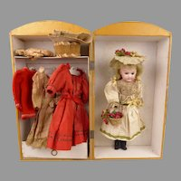 Original antique factory made trousseau in trunk/cabinet with doll from 1904