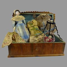 Very rare early antique wooden doll trunk with china doll and antique trousseau